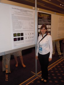 Iva next to her poster